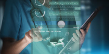 modern woman nurse or doctor is using innovative technologies, touching a holographic panel for monitoring patient general health data and recording a live myocardial biopsy scan